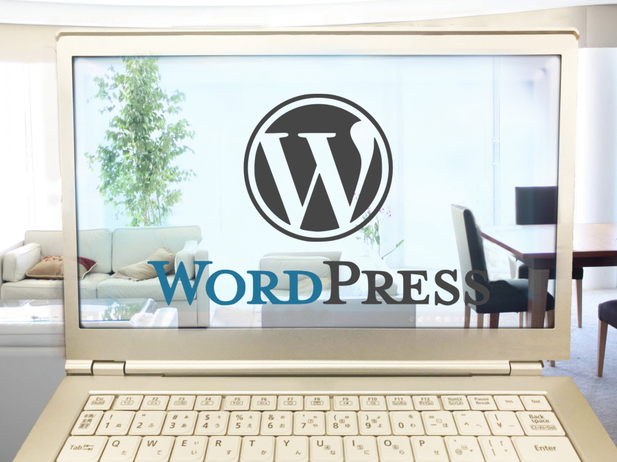 パソコンとWordPressのロゴ